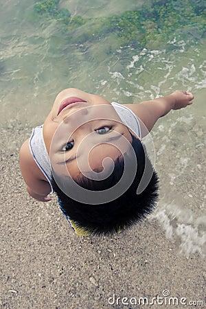 Asian boy having fun on beach