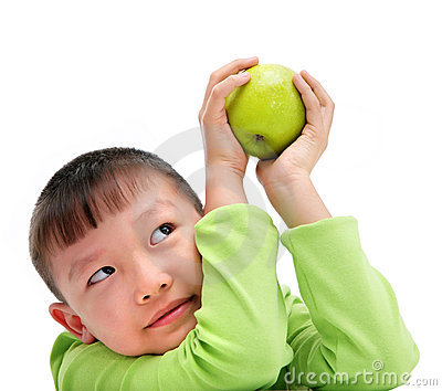 Asian boy holding a big green apple