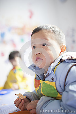 Asian boy learning the painting