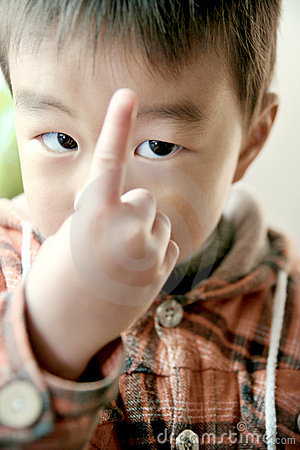 Asian boy look at his finger