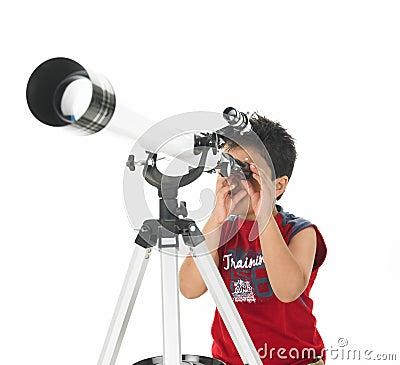 Asian boy looking through a telescope