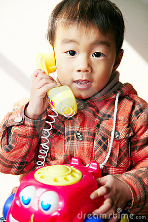 Asian boy play with telephone