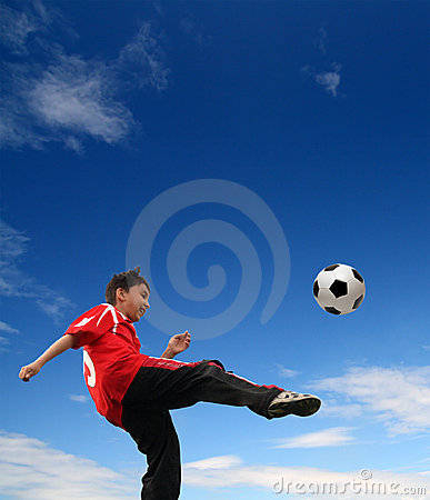 Asian boy playing football