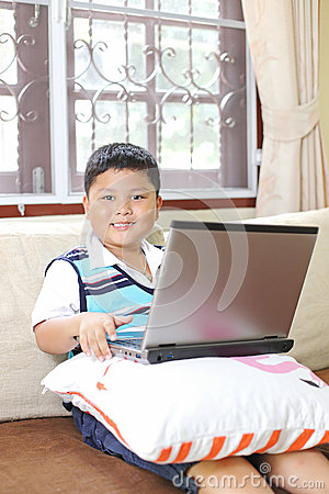Asian boy playing notebook