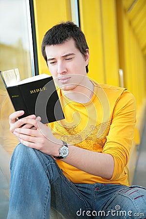 Asian boy  reads bible
