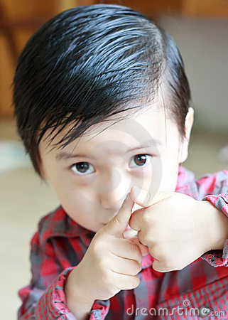 Asian Boy Showing his Thumb