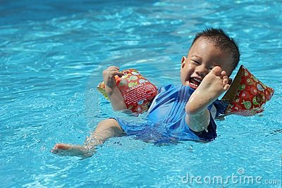 Asian boy swimming