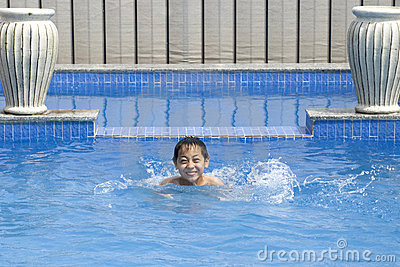 Asian boy is swimming in pool