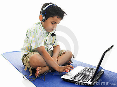 Asian boy typing into his laptop