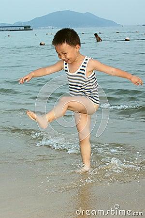 An Asian boy in wave