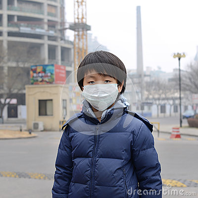 Free Asian Boy Wearing Mouth Mask Against Air Pollution Royalty Free Stock Photo - 37522625
