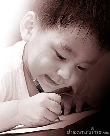 Asian boy writing on paper
