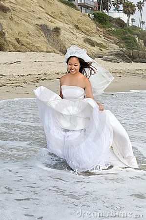 Asian bride at the beach