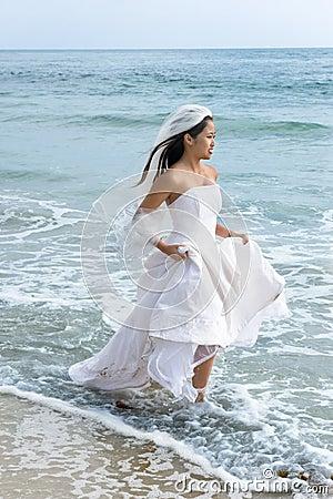 Asian bride at beach