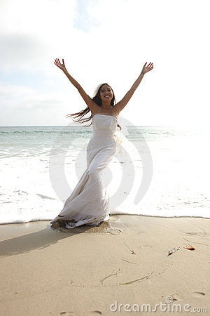 Asian Bride Celebrating Her Joy on the Beach