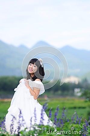Asian bride on a field