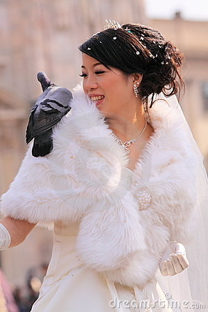 Asian bride with pigeon Editorial Photography