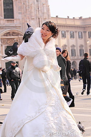 Asian bride with pigeon in milan Editorial Photo