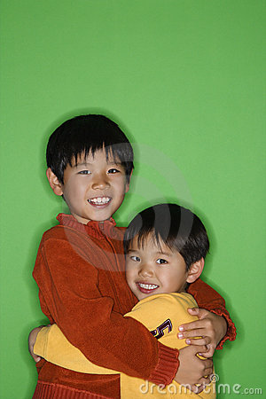 Asian brothers hugging