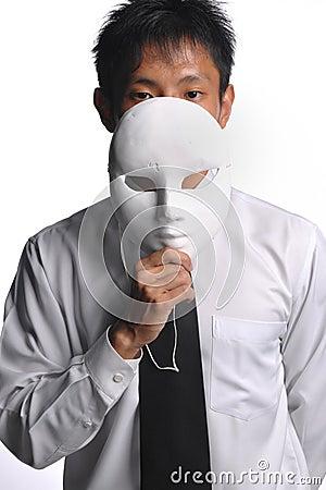 Asian business man hiding behind mask