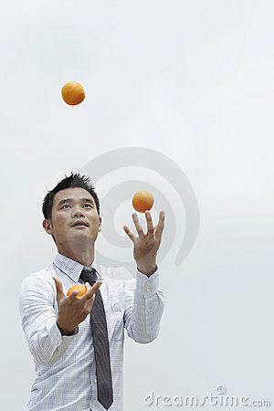 Asian Business man juggling