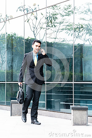 Free Asian Business Man Talking To Cell Phone Outside Stock Photos - 48939003
