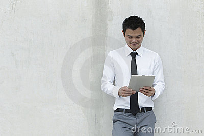 Asian Business man using a Digital Tablet