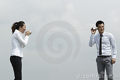 Asian Business man and woman using Tin Can Phone.