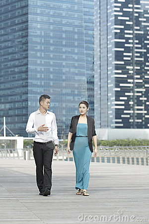 Asian Business Man and Woman Walking