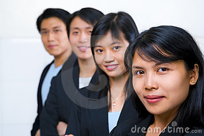 Asian business people line up