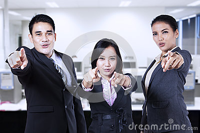 Asian business team pointing