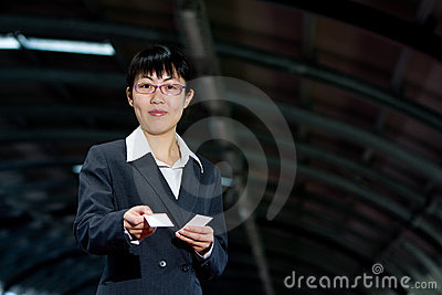 Asian business woman with calling card