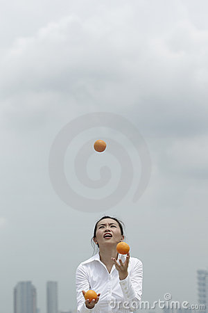 Asian Business woman juggling