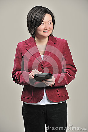Asian business woman with tablet computer