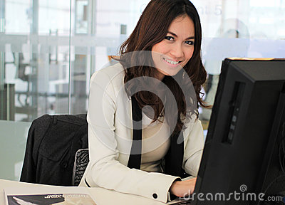 Asian business woman using a computer