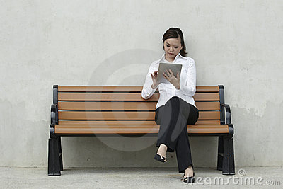 Asian Business woman using a Touch-Pad PC