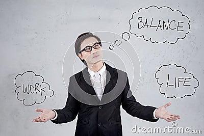 Asian businessman balancing work and life