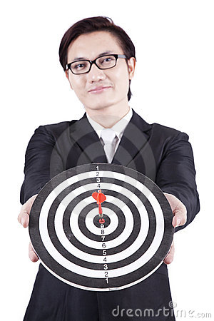 Asian businessman holding dartboard
