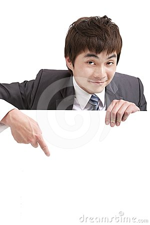 Asian  businessman pointing empty board