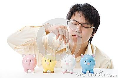 Asian businessman saving money