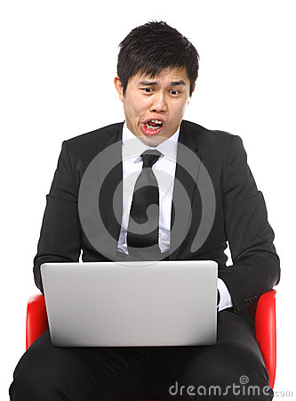 Asian businessman shocked surprise by laptop computer