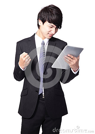 Asian businessman using touch pad with annoyed face