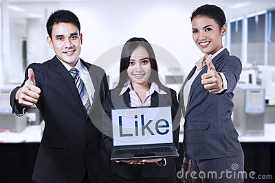 Asian businessteam showing like on laptop