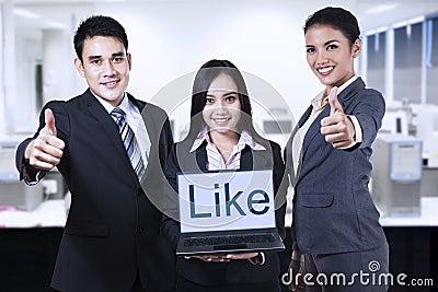Asian businessteam showing like on laptop