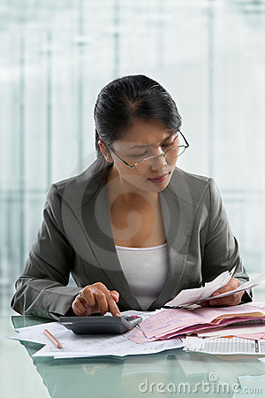 Asian businesswoman checking bills