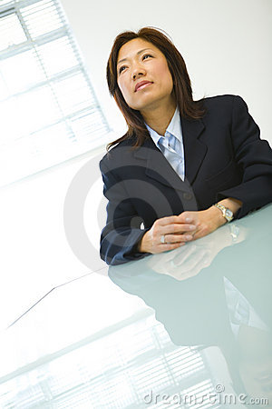 Asian businesswoman at desk