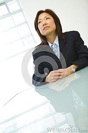 Asian businesswoman at desk