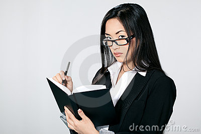 Asian businesswoman with diary