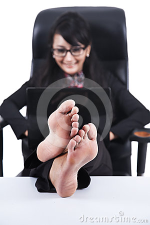 Asian businesswoman with Feet Up on a desk
