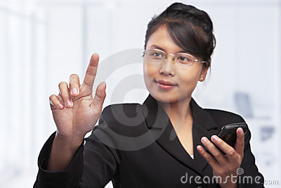 Asian businesswoman pointing her finger tip